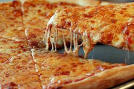 Trostomaatjes op eigen pizza koningin Beatrix